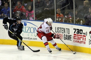 Jared Staal plays the puck against the Milwaukee Admirals in Charlotte in December, 2012. (Photo - J. Propst)