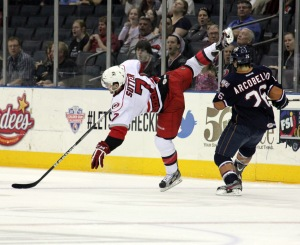 Charlotte Checkers captain Brett Sutter goes flying during game three against the Oklahoma City Barons. (Photo - J. Propst)