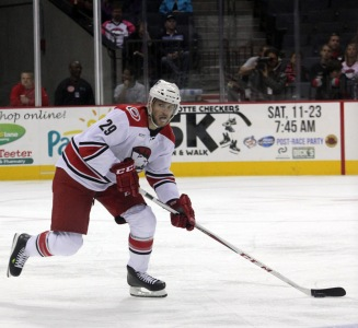 Charlotte Checkers defenseman Michal Jordan skates with the puck down the ice in the team's 7-2 loss to the Iowa Wild. (Photo - J. Propst)