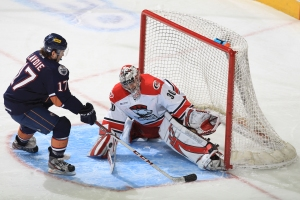 Charlotte Checkers goaltender John Muse stops a shootout attempt by OKC Barons center Alex Lavoie.  (Photo credit: Gregg Forwerck/Charlotte Checkers)
